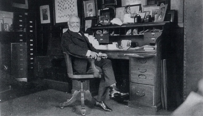 Historic photo of Andrew Carnegie at desk