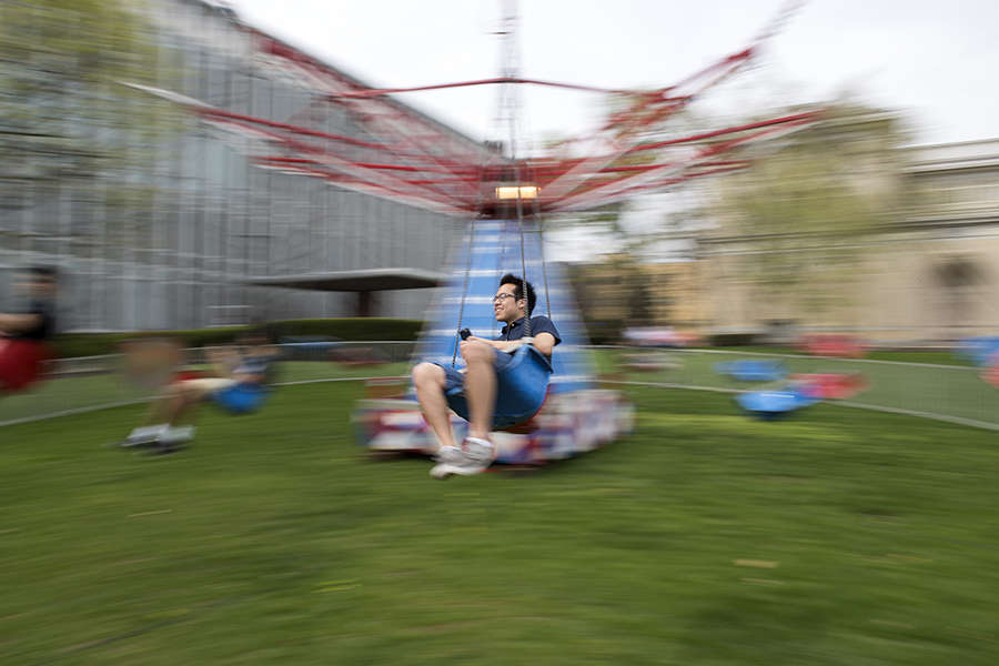 A photo of a student riding a fair ride